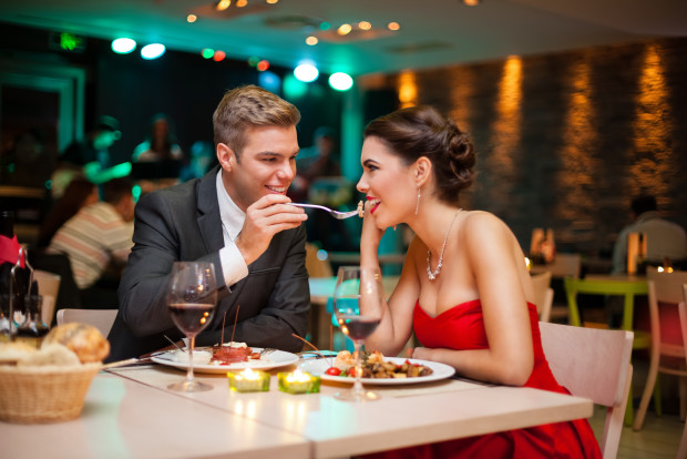 Lovely young couple eating on romantic dinner